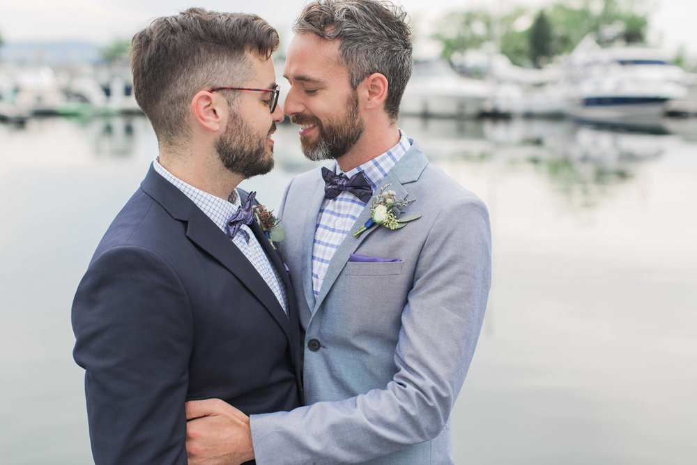 Two Canadian Grooms canoodling