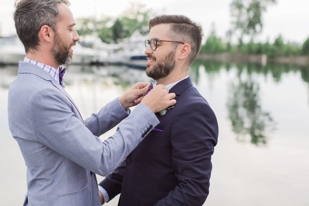 Groom fixing his husband's bowtie