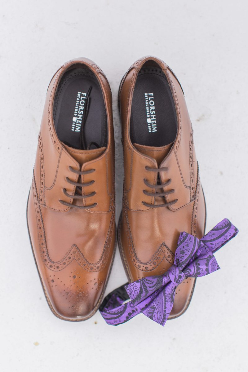 purple bowtie and dress shoes