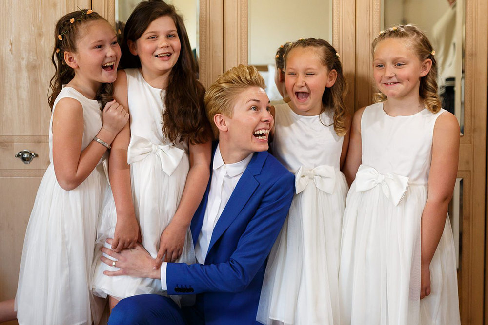 dapper bride with flower girls