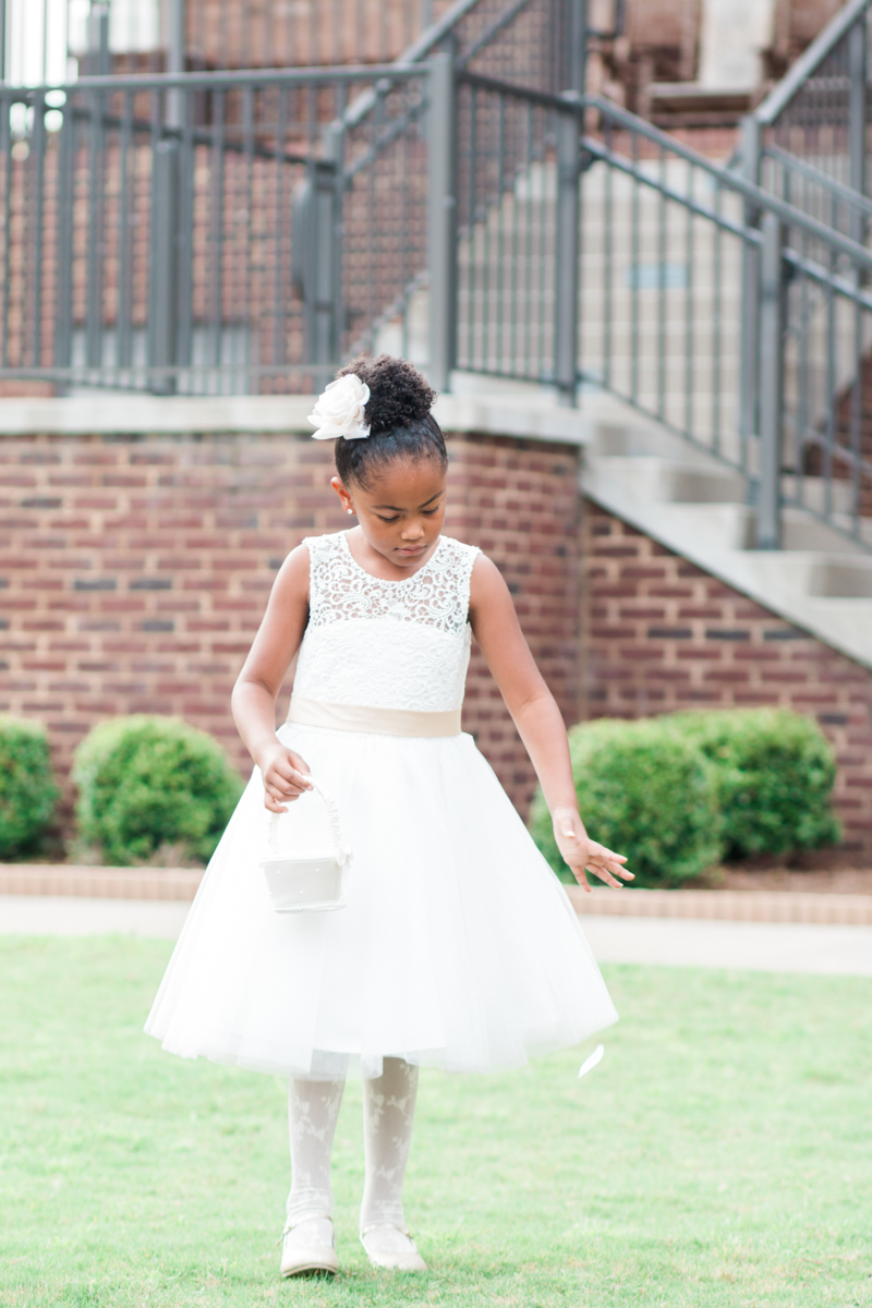 Flower girl dropping rose petals