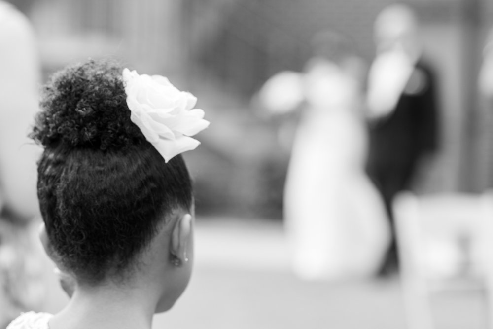 flower girl with flower in her hair