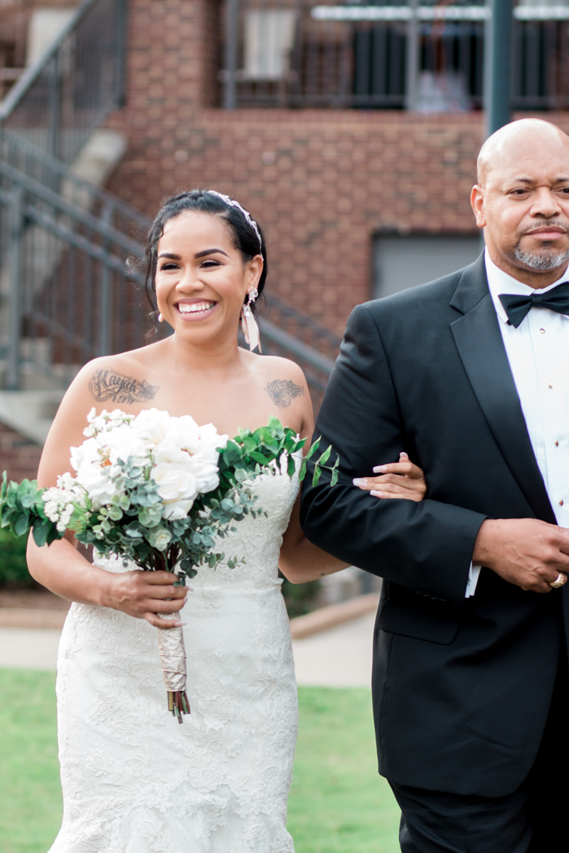 Bride walking with her dad down the aisle