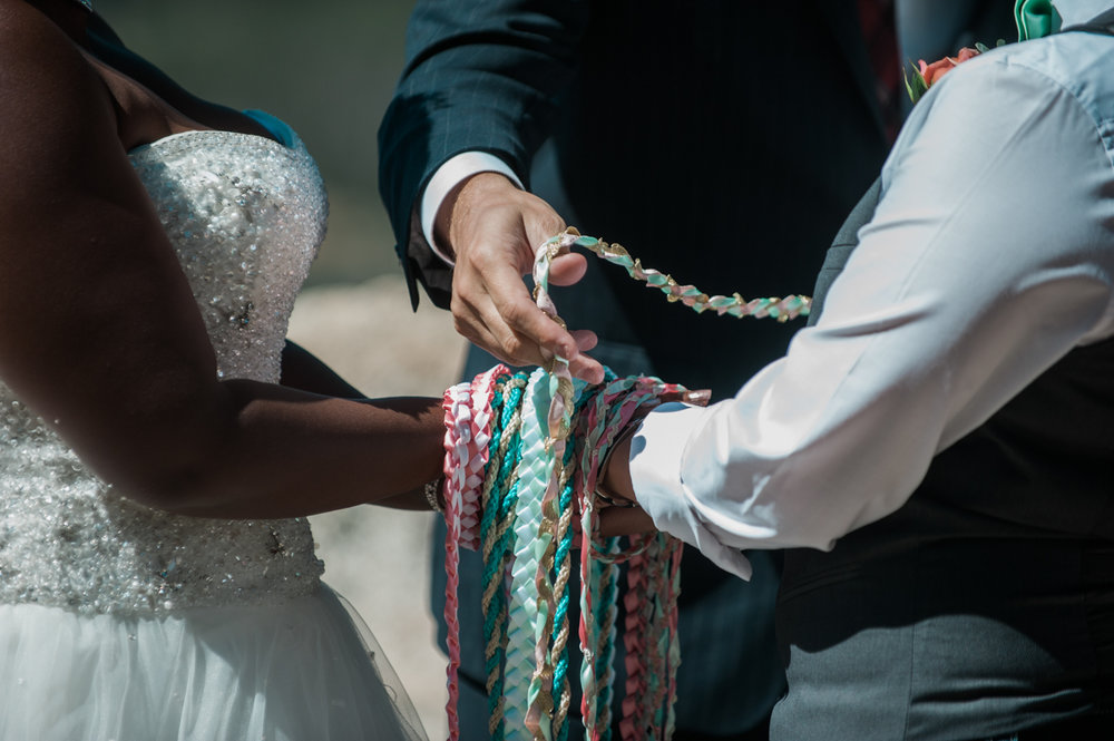 mountain elopement cords on hands