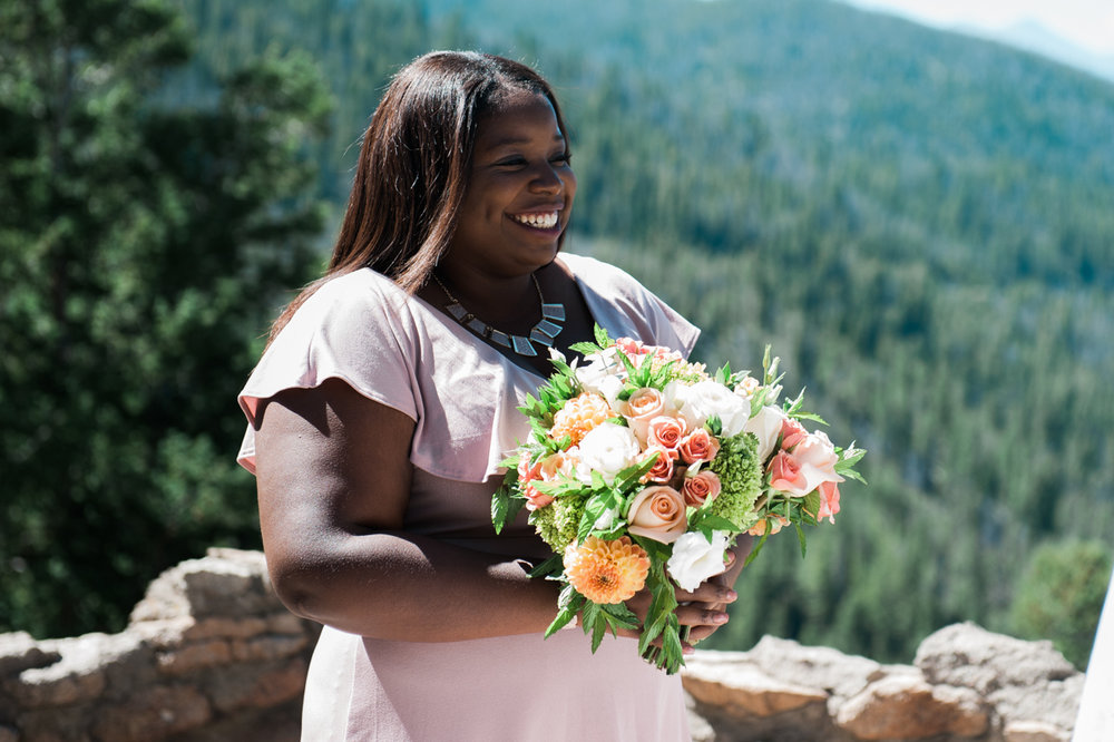 mountain elopement smiling bridesmaid