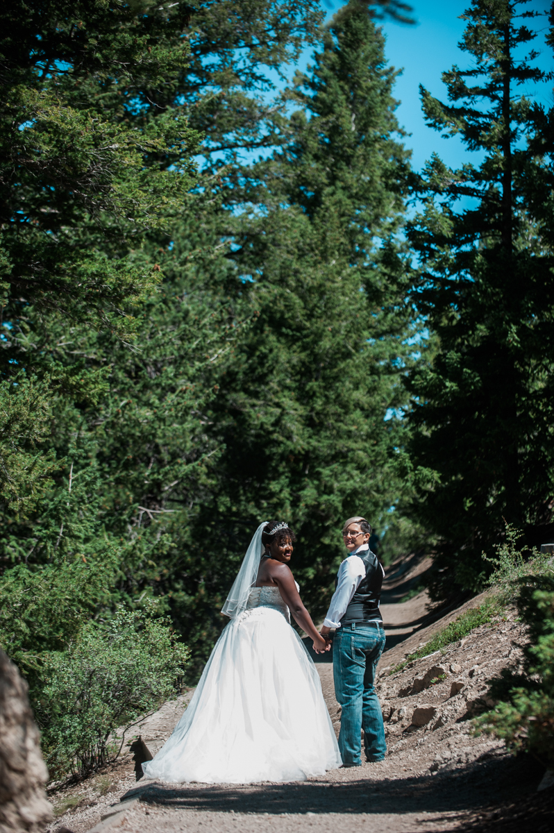 mountain elopement couple holding hands