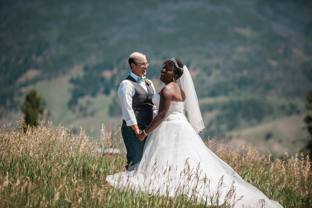 mountain elopement couple in field of tall grass