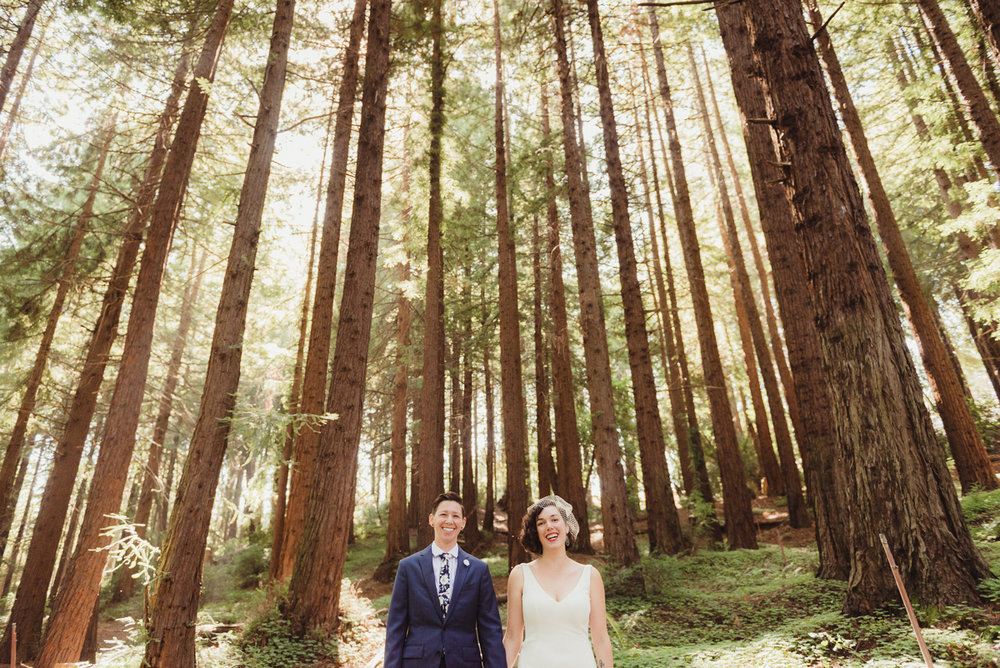 uc berkeley garden wedding pose among tall trees