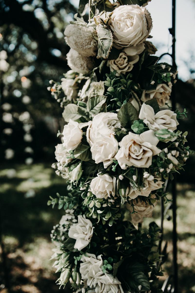 San antonio garden wedding flowers wrapped on fence