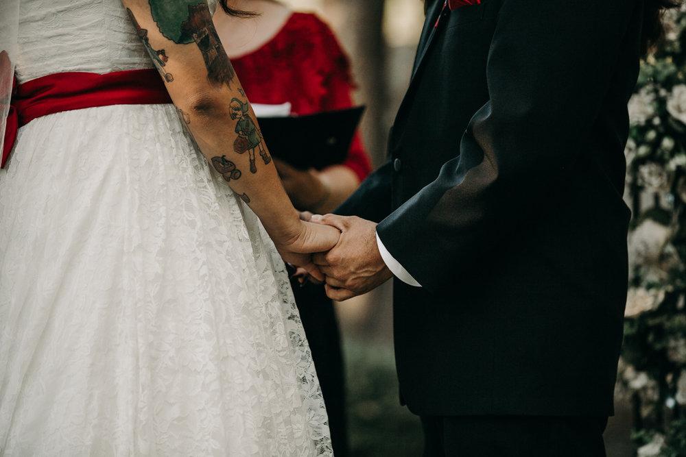 San antonio garden wedding holding hands at altar