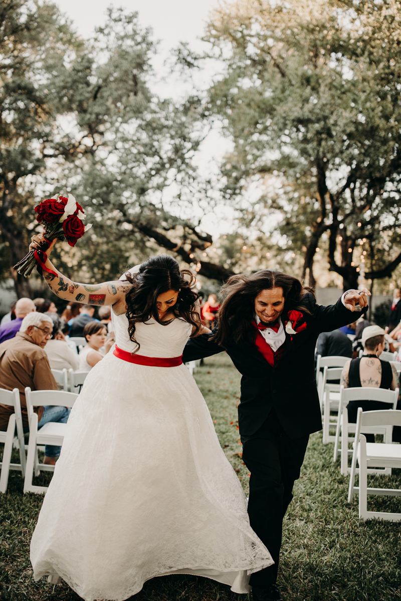 San antonio garden wedding couple dancing down aisle