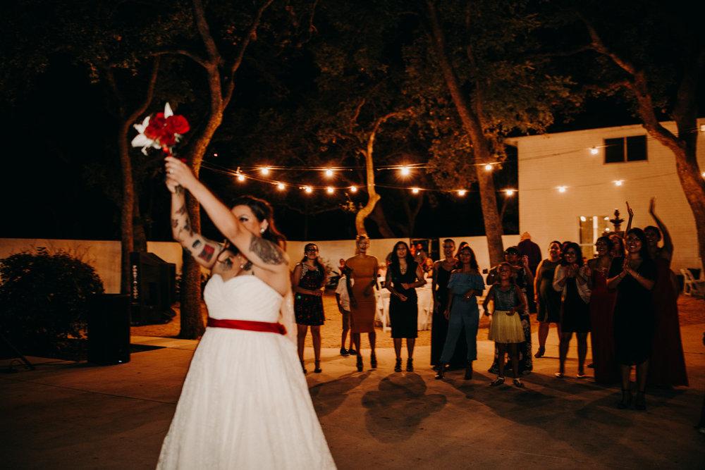 San antonio garden wedding bride tossing bouquet