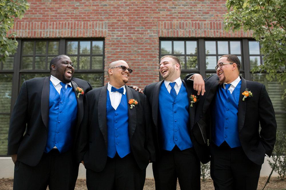 Ballroom wedding charlotte nc groom with groomsmen outside