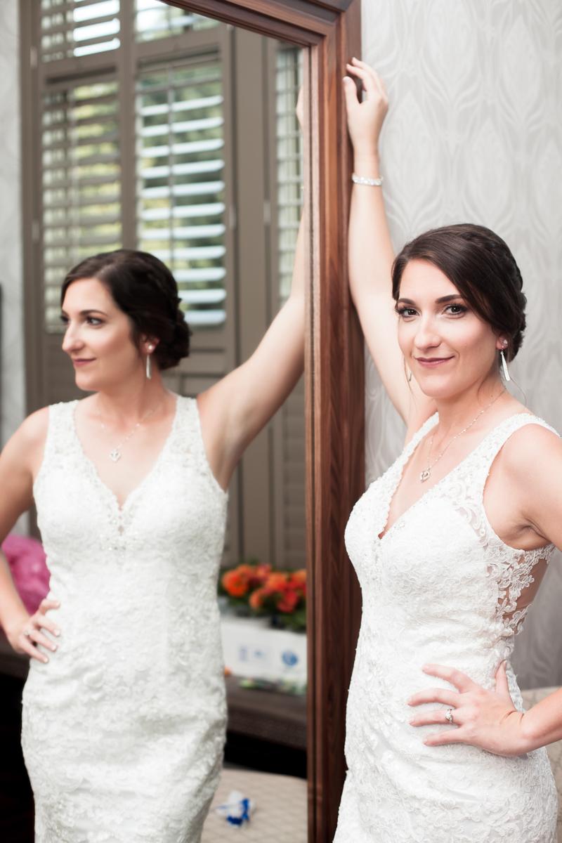 Ballroom wedding charlotte nc bride posing at mirror