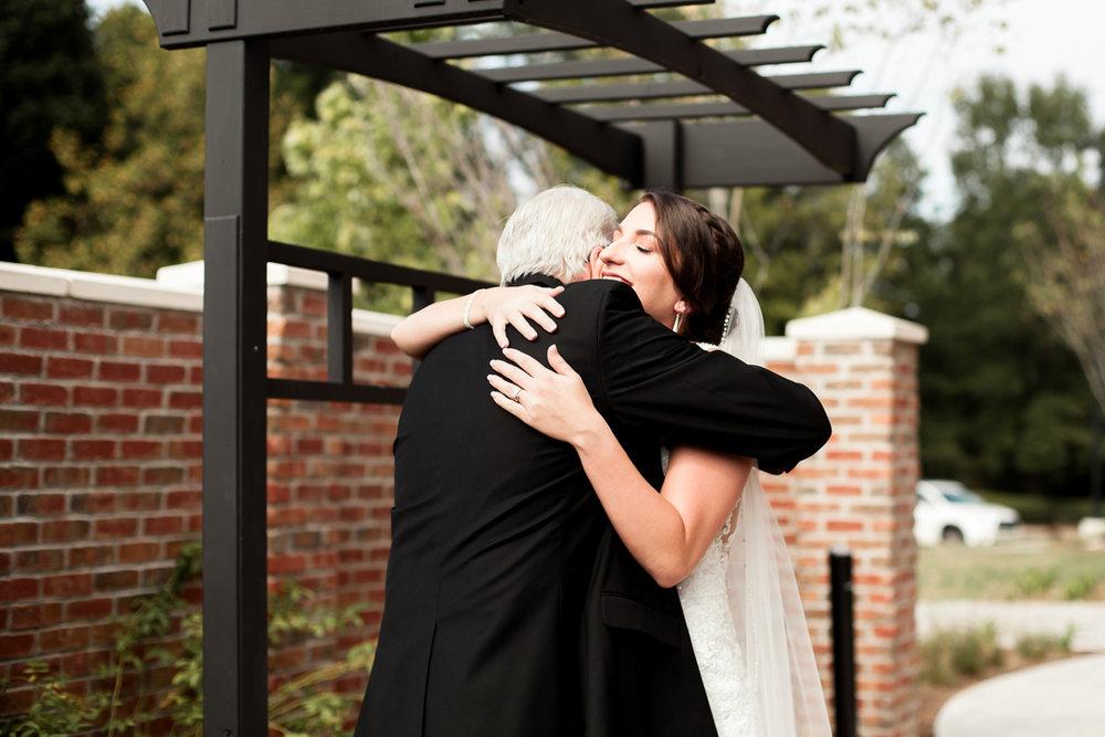 Ballroom wedding charlotte nc bride and dad hug