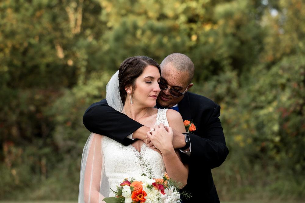 Ballroom wedding charlotte nc groom with arms around bride