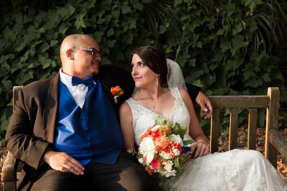 Ballroom wedding charlotte nc couple on bench