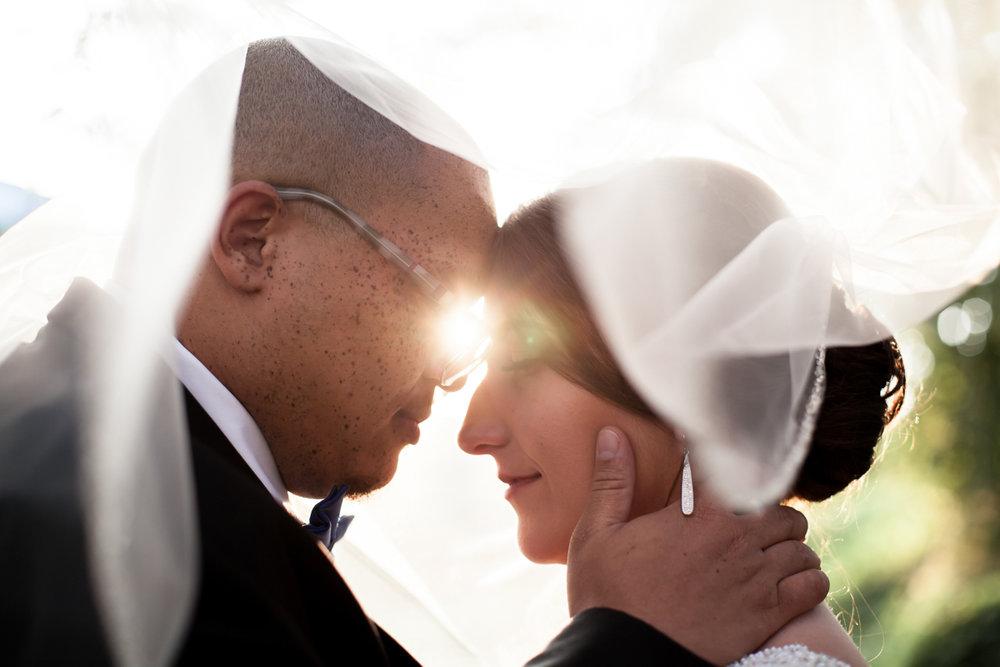 Ballroom wedding charlotte nc embrace in sunlight