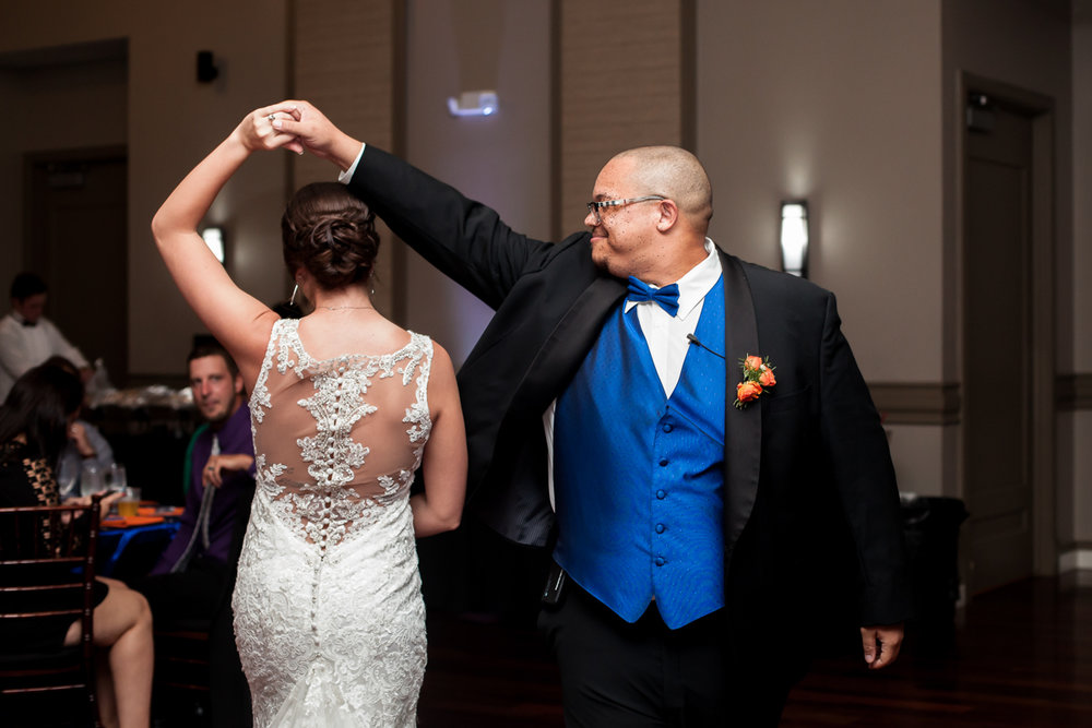 Ballroom wedding charlotte nc groom spinning bride on dance floor
