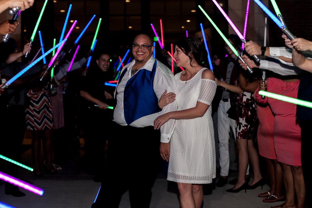 Ballroom wedding charlotte nc light saber tunnel for couple