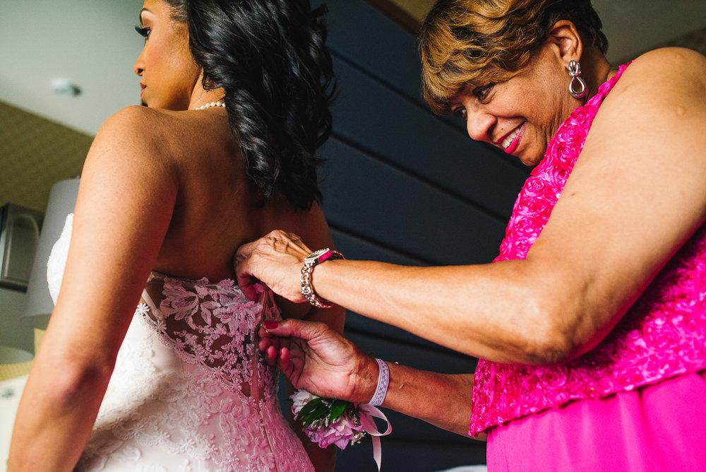 mount vernon ballroom wedding bride having dress zipped
