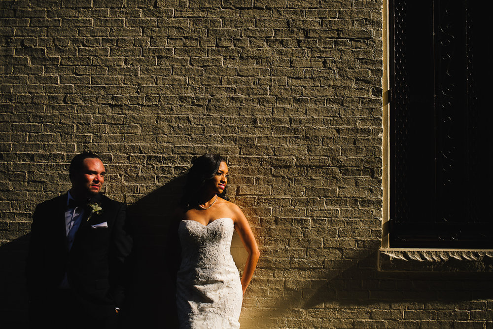 mount vernon ballroom wedding couple leaning against brick wall