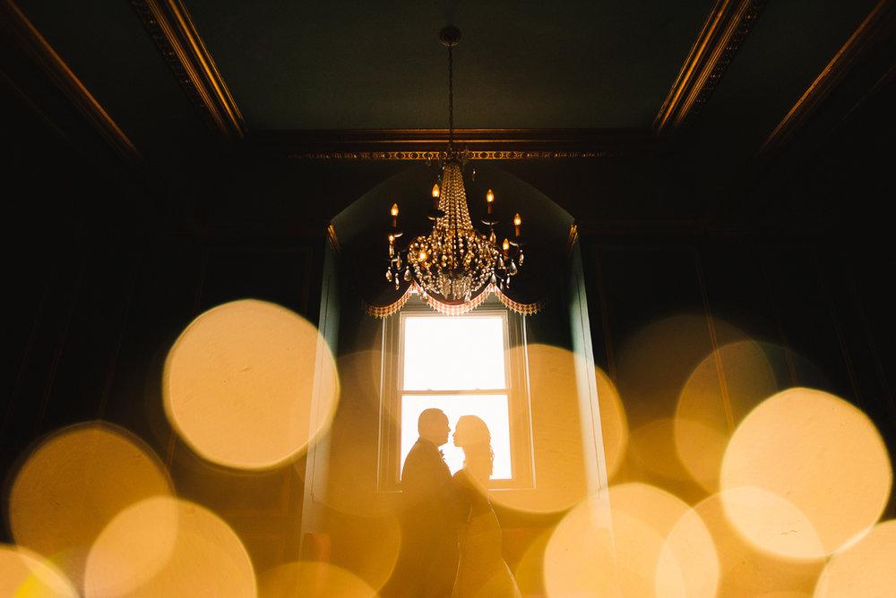 mount vernon ballroom wedding couple in front of window