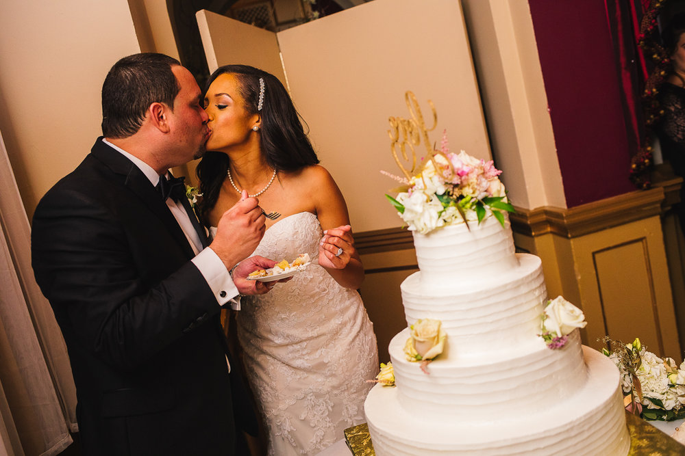 mount vernon ballroom wedding couple kissing after cutting cake