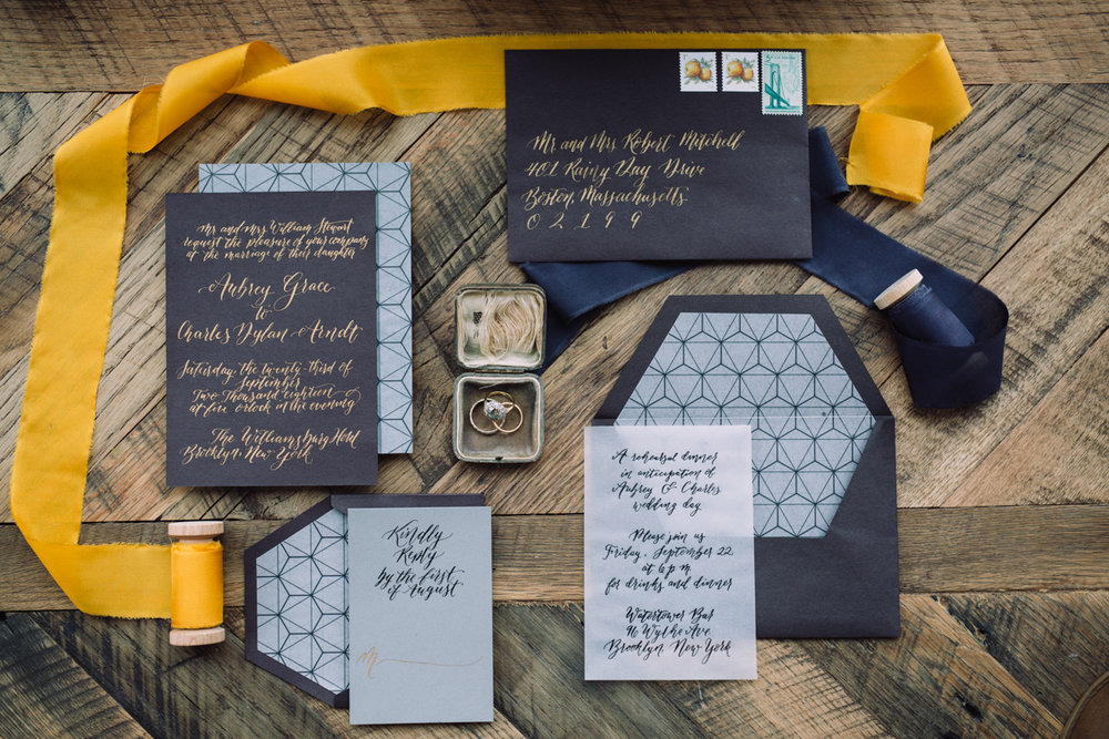 williamsburg hotel wedding shoot invitation layout with coordinating ribbon spools