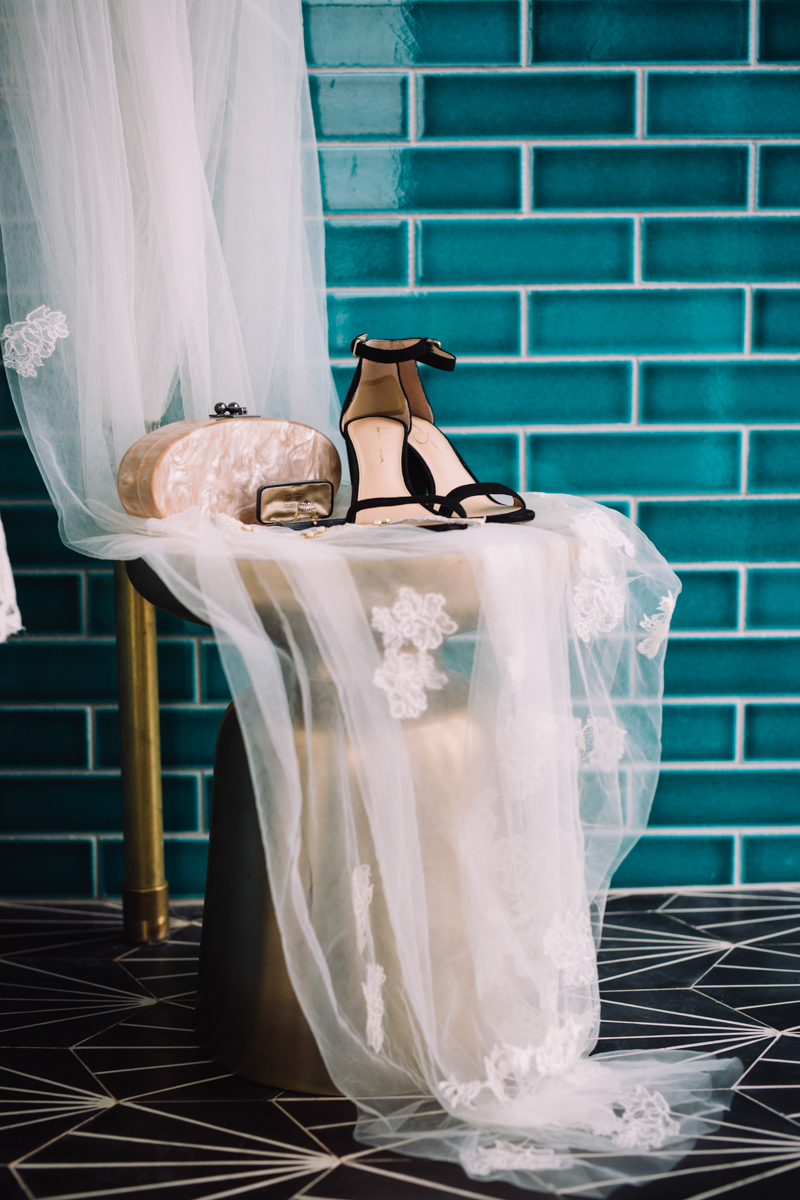 williamsburg hotel wedding shoot bride's shoes and accessories on lace-draped chair