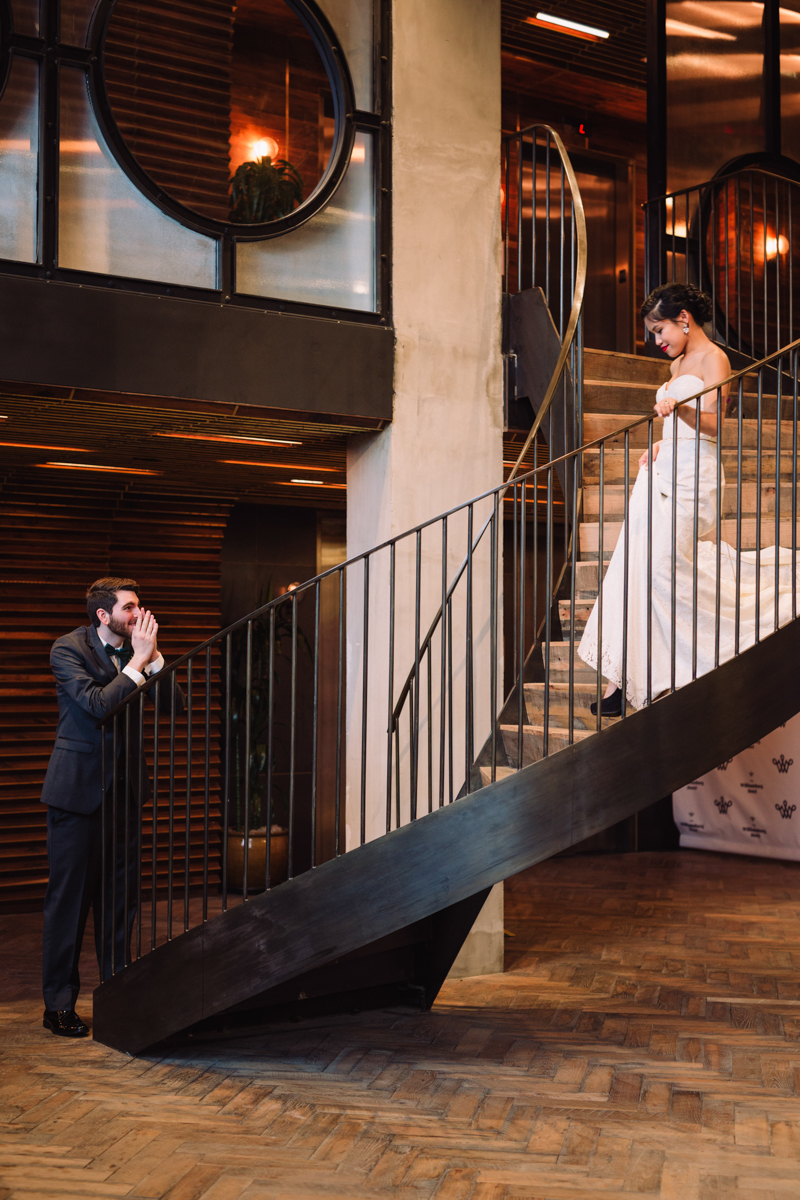 williamsburg hotel wedding shoot bride descending stairs to groom