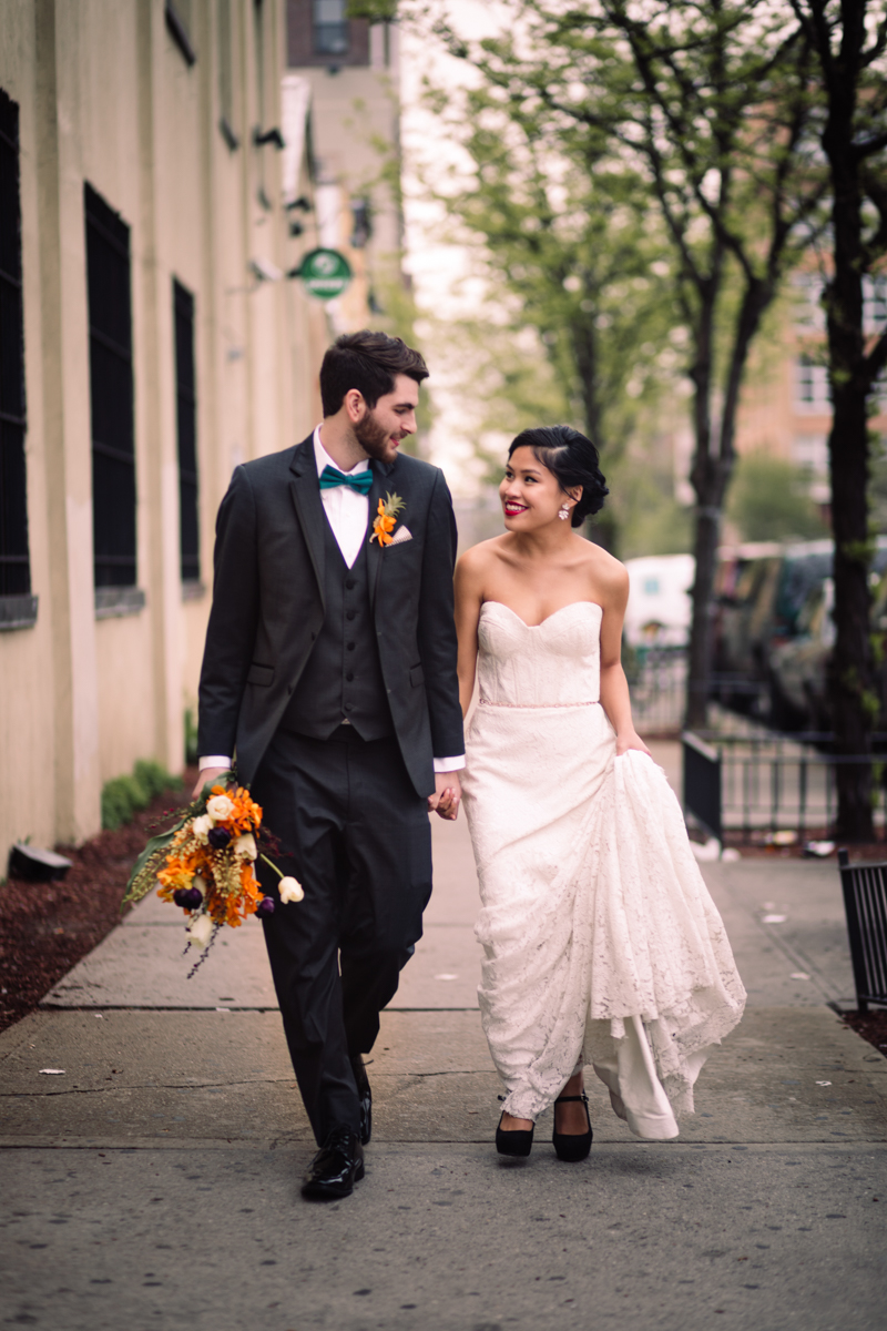williamsburg hotel wedding shoot couple walking down sidewalk