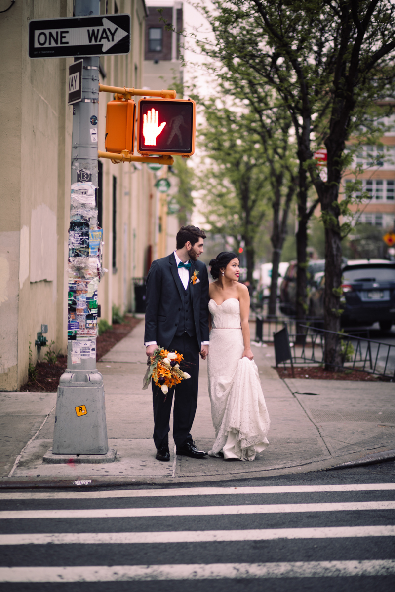 williamsburg hotel wedding shoot couple waiting at crosswalk