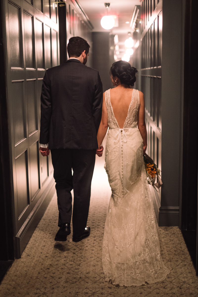 williamsburg hotel wedding shoot couple walking in hallway of hotel