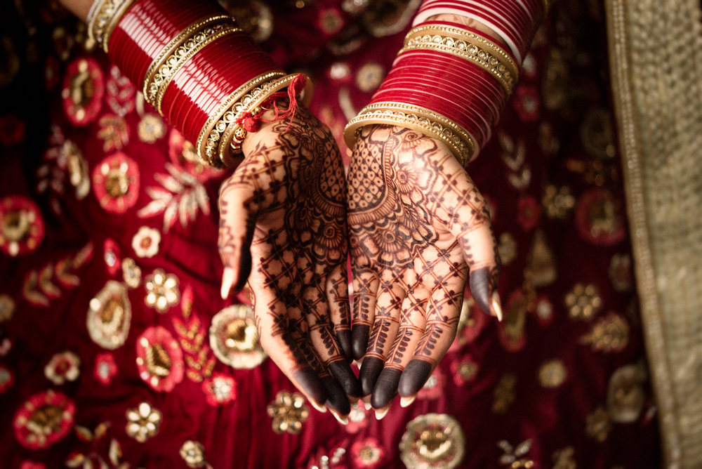 edmonton Indian and filipino wedding bride's hands covered in henna tattoos