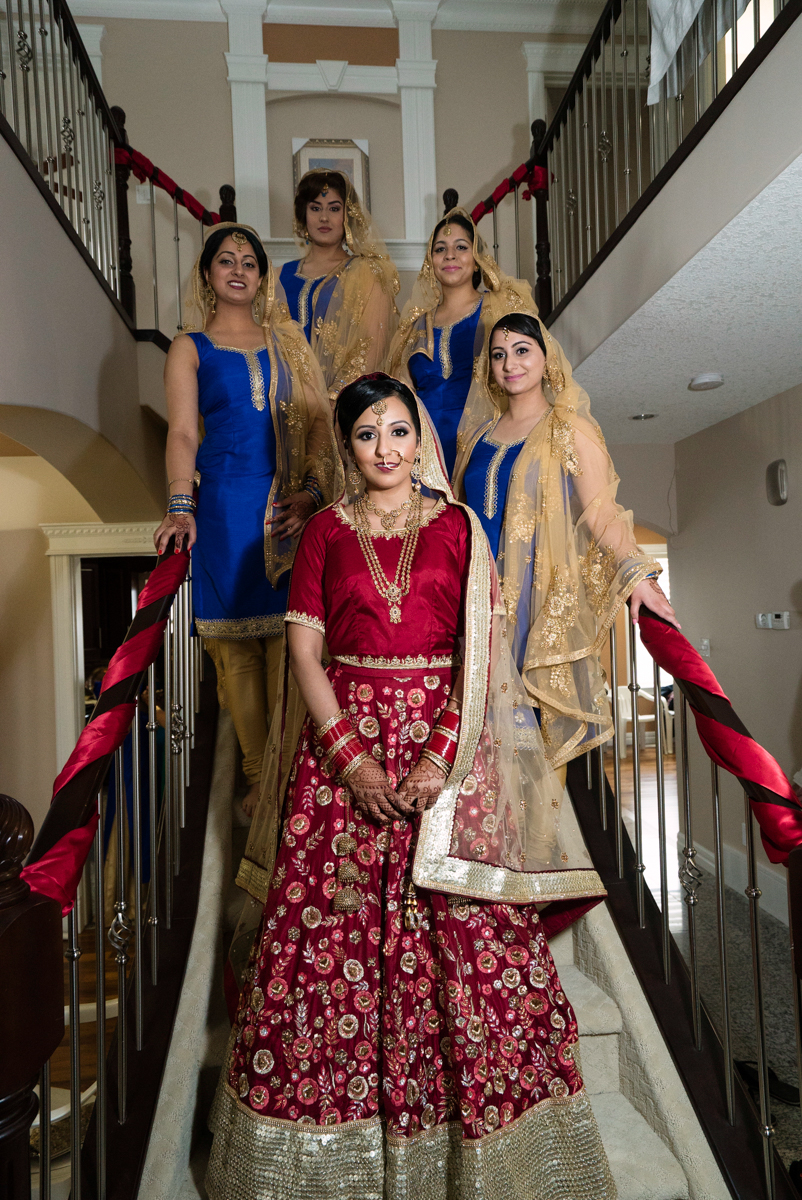 edmonton Indian and filipino wedding bride and bridesmaids on staircase