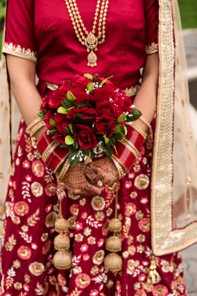 edmonton Indian and filipino wedding bride holding bouquet