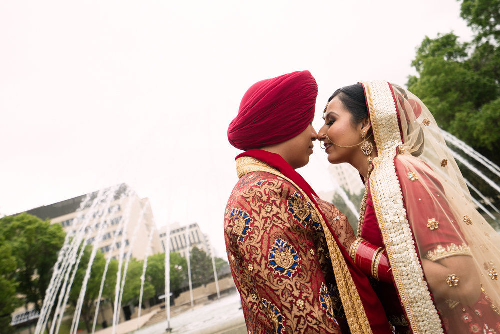 edmonton Indian and filipino wedding couple by fountain