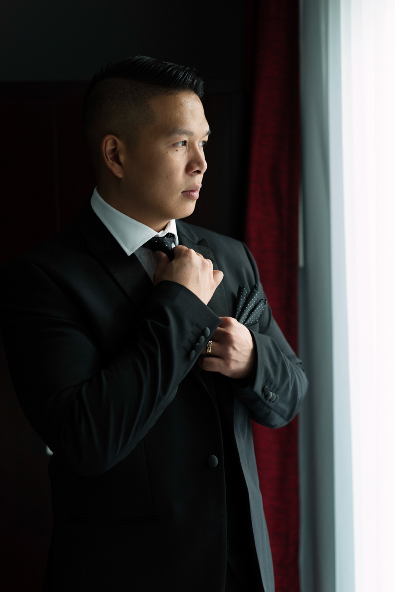 edmonton Indian and filipino wedding groom in suit