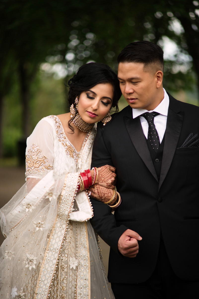 edmonton Indian and filipino wedding couple in park