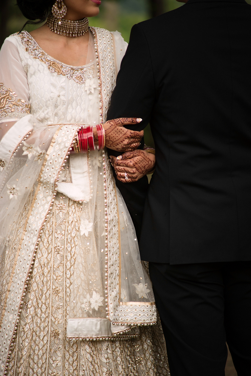edmonton Indian and filipino wedding couple with linked arms