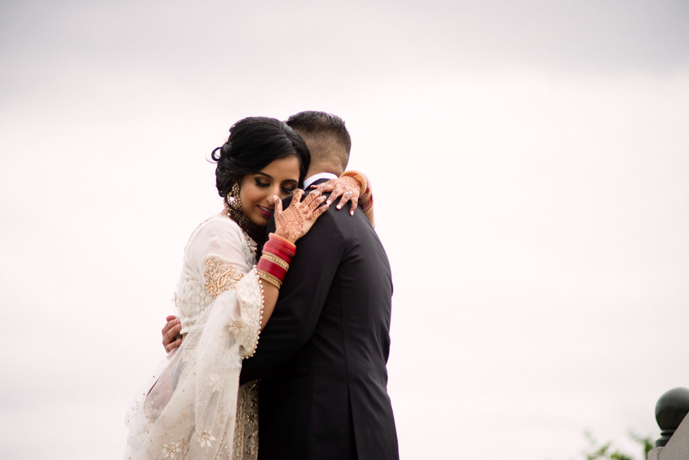 edmonton Indian and filipino wedding embrace