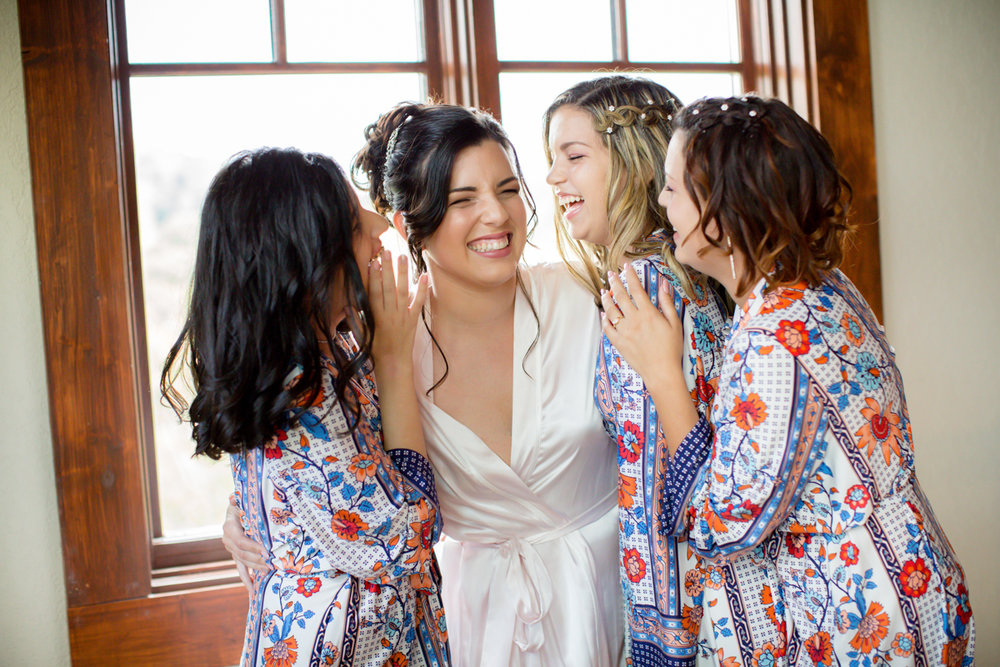 Private Estate Wedding in Boone, NC bride and bridesmaids laughing