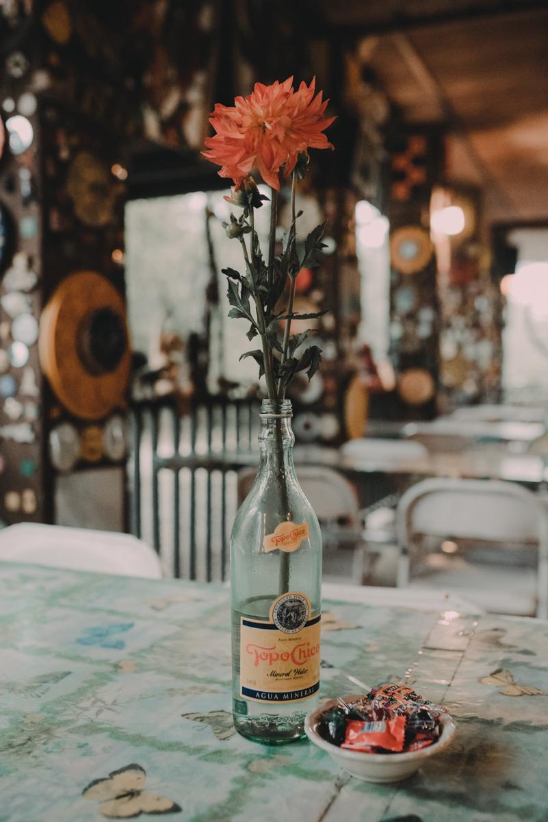 intimate, eclectic austin wedding flower in bottle centerpiece