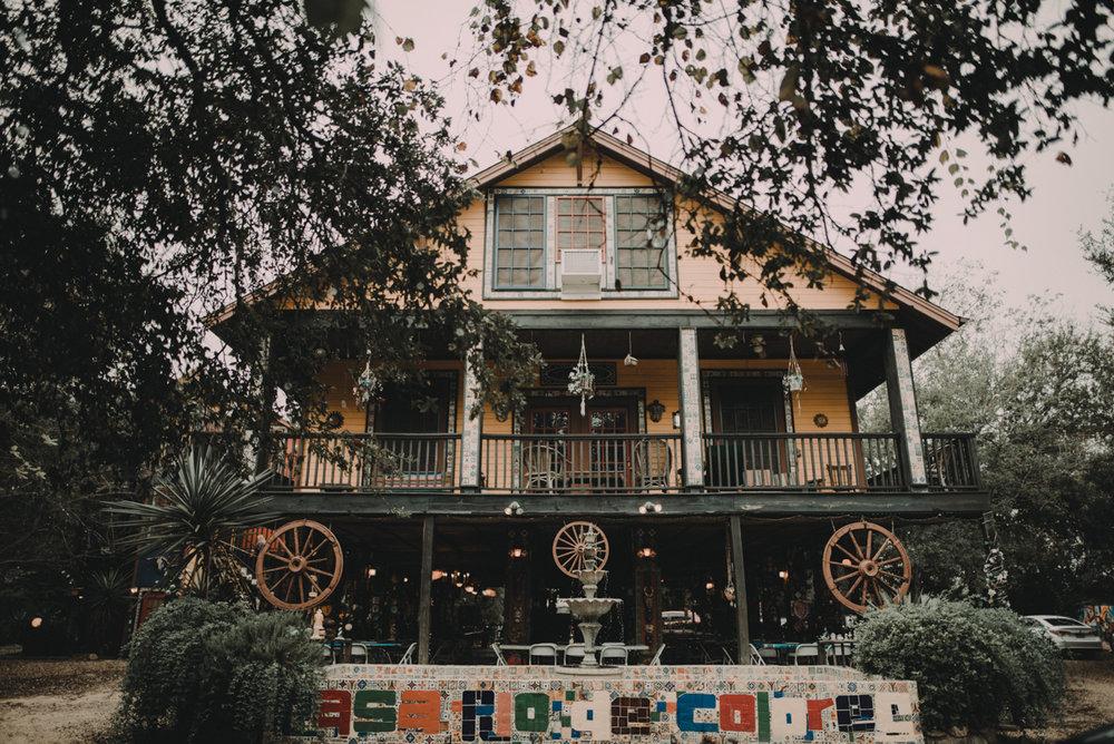 intimate, eclectic austin wedding front of casa rio de colores