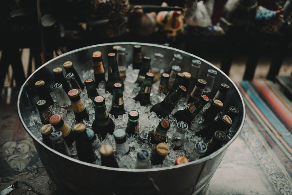 intimate, eclectic austin wedding tin pail full of drinks