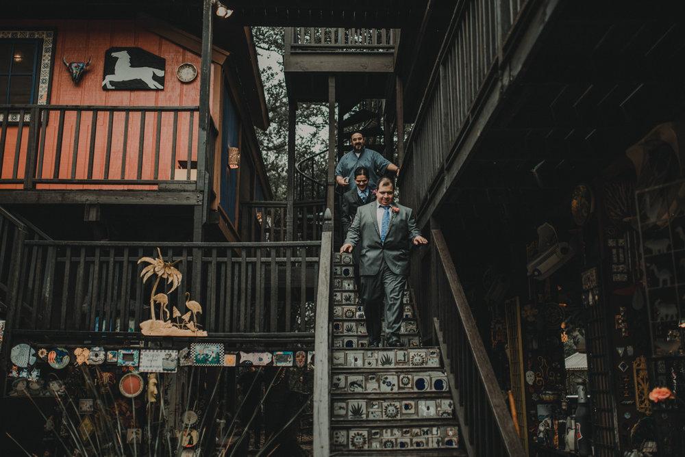 intimate, eclectic austin wedding juan and groomsmen descending stairs