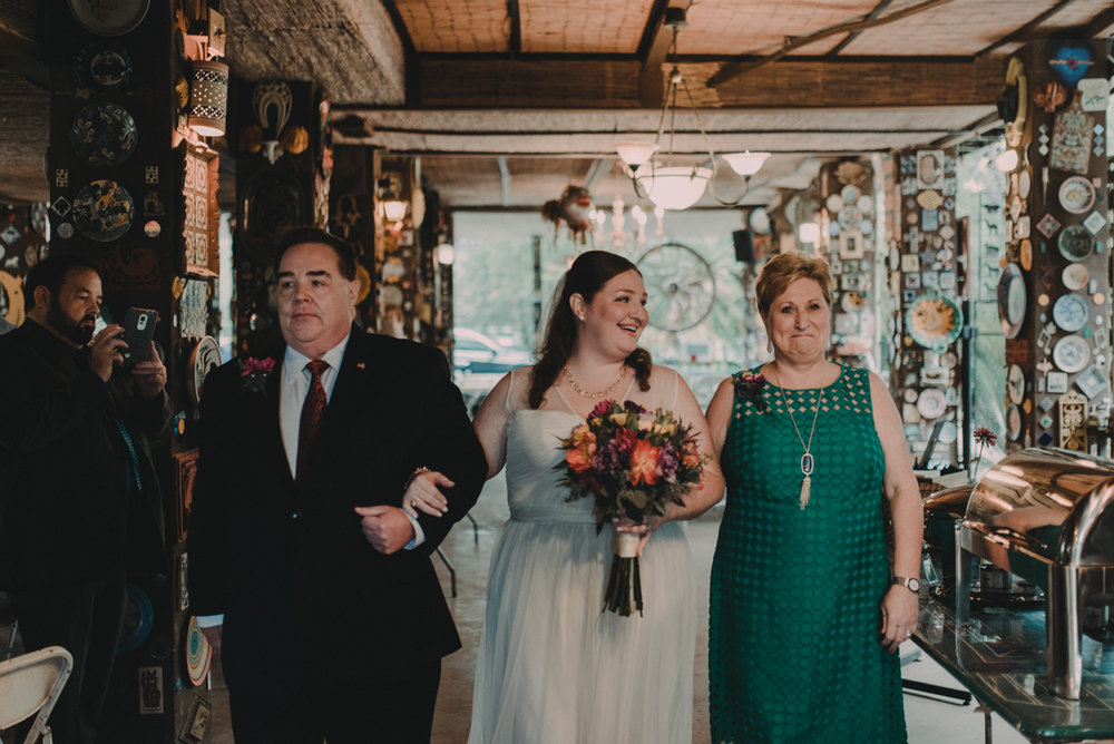 intimate, eclectic austin wedding jennifer and parents walking down aisle