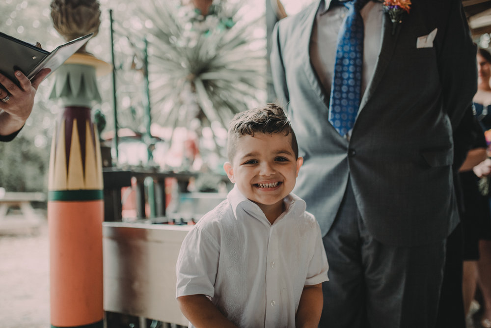 intimate, eclectic austin wedding young boy standing with juan