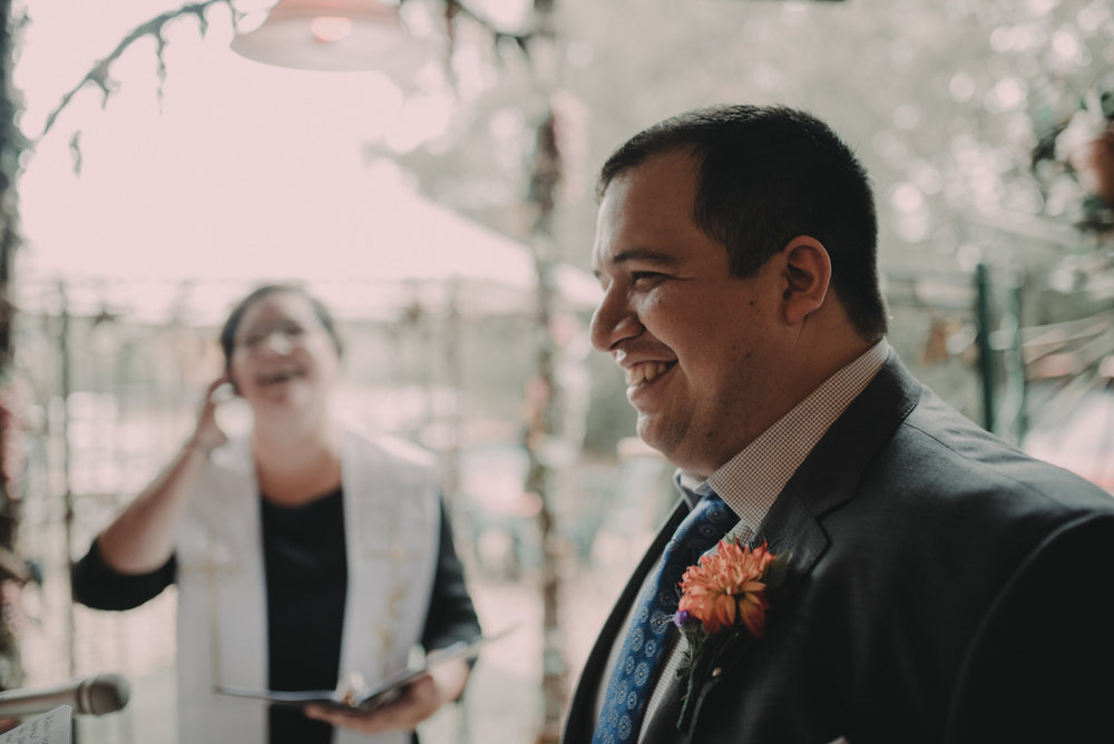 intimate, eclectic austin wedding juan and officiant laughing